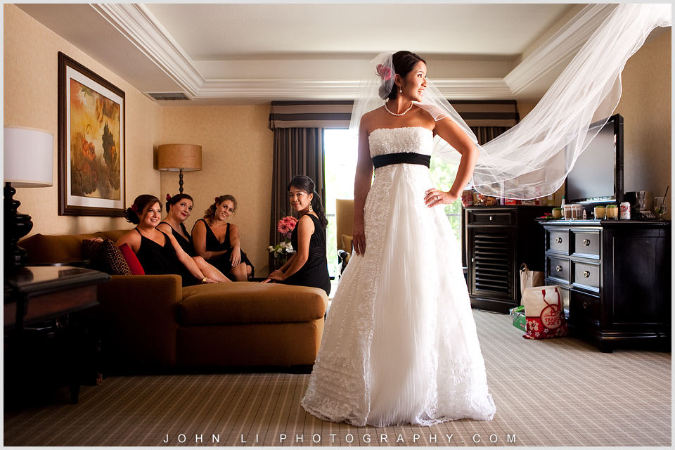 bride looks at the veil Hyatt Westlake Plaza in Thousand Oaks
