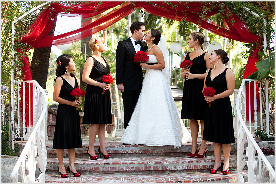 groom with all the girl in Rancho De Las Palmas group photo