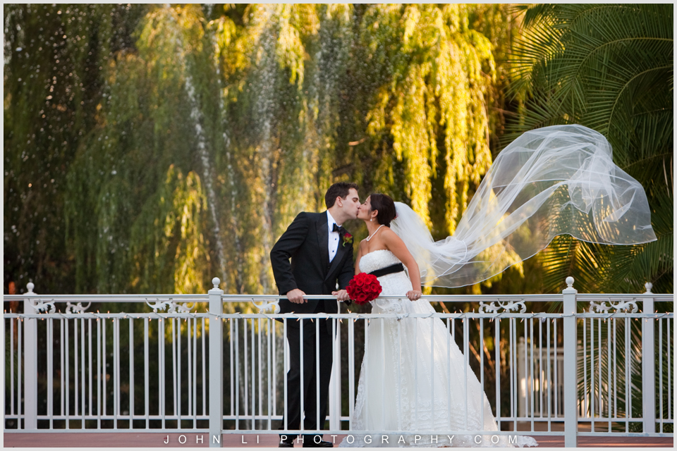 Rancho De Las Palmas bridal portrait on the bridge