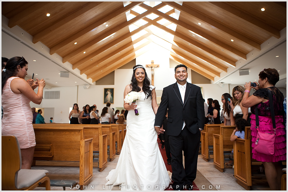 Bride and Groom walked down the aisle in St. Peter Chanel Chuch