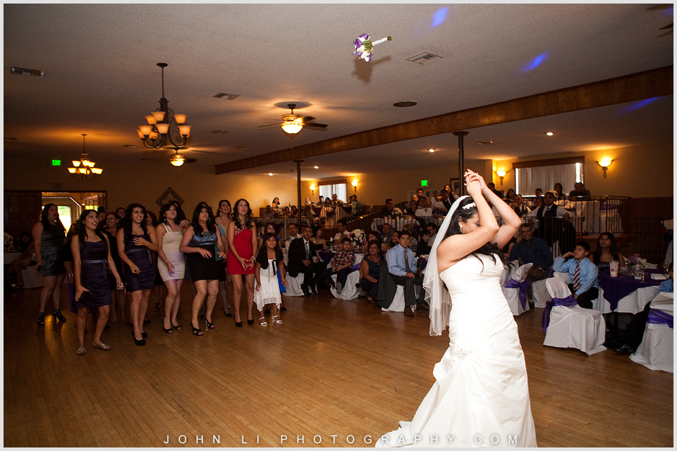 Bouquet toss DES Artesia Halls Wedding reception