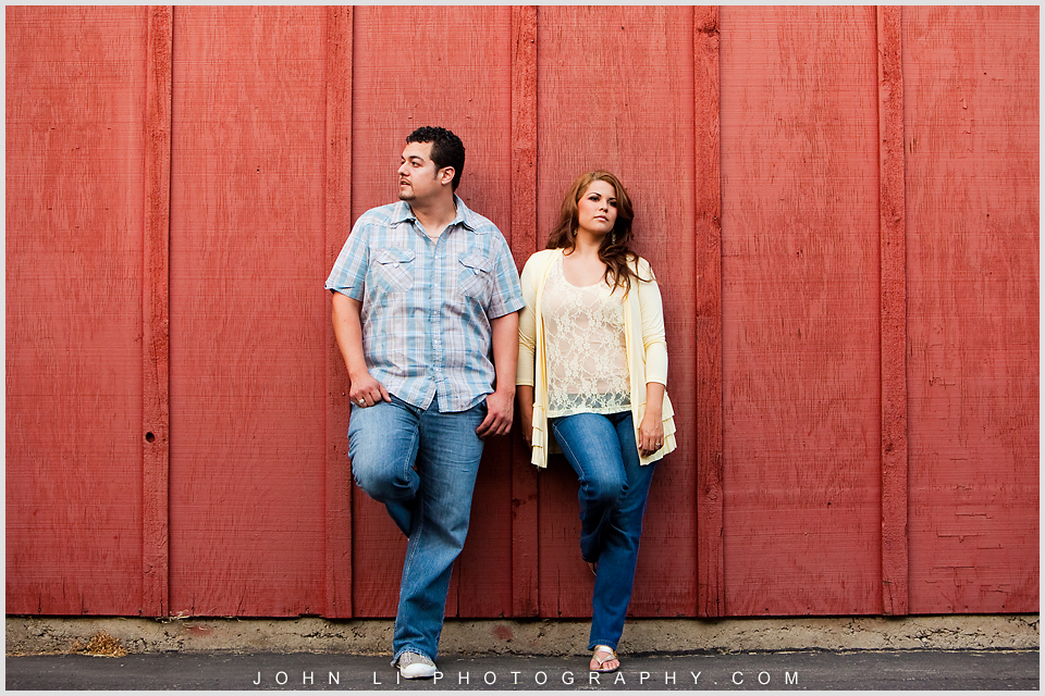 red background engagement photos in La Verne