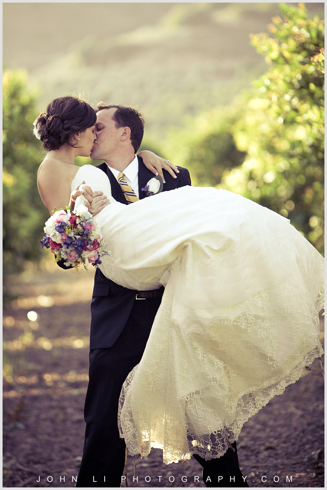 Limoneira Ranch wedding photos bride and groom kiss each other