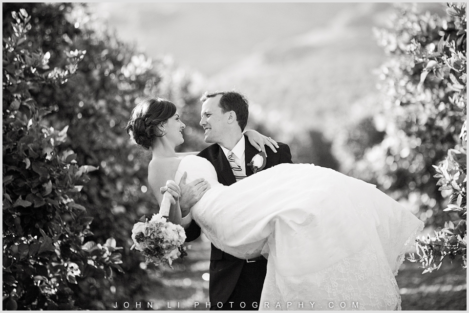 Limoneira Ranch wedding images  bride and groom kiss each other