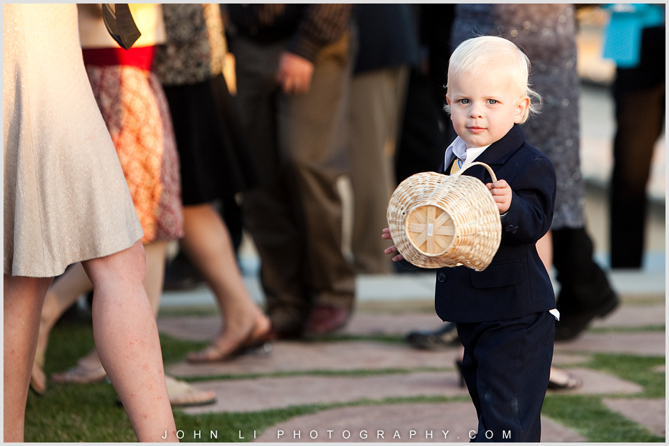 Santa Paula Limoneira Ranch Wedding reception boy with a basket