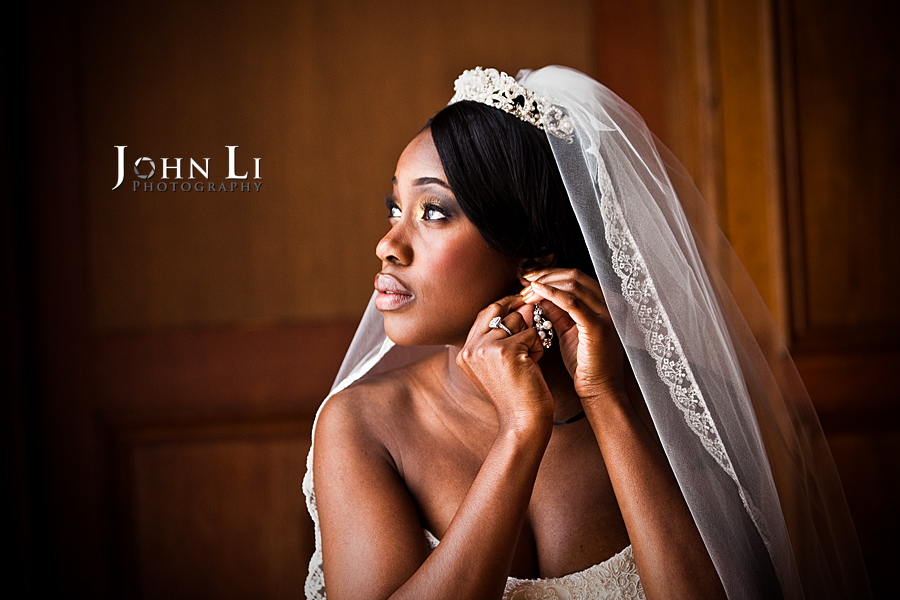 Bride fixes the earring in Park Plaza Hotel in Los Angeles