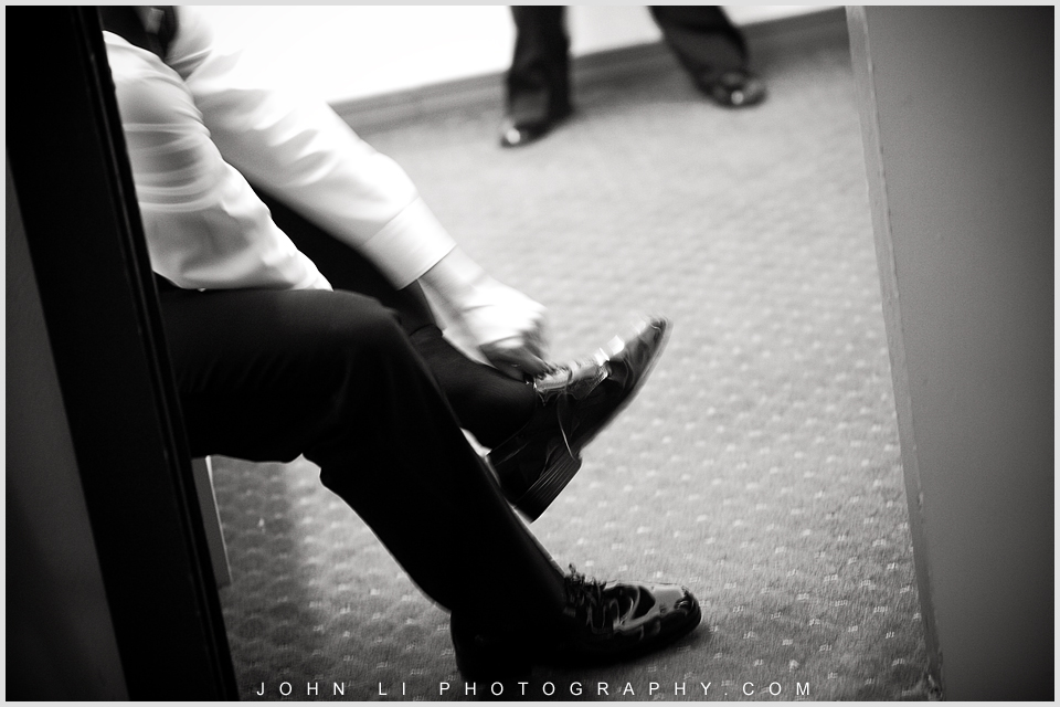 Galamigos Ranch wedding groom put the shoes on