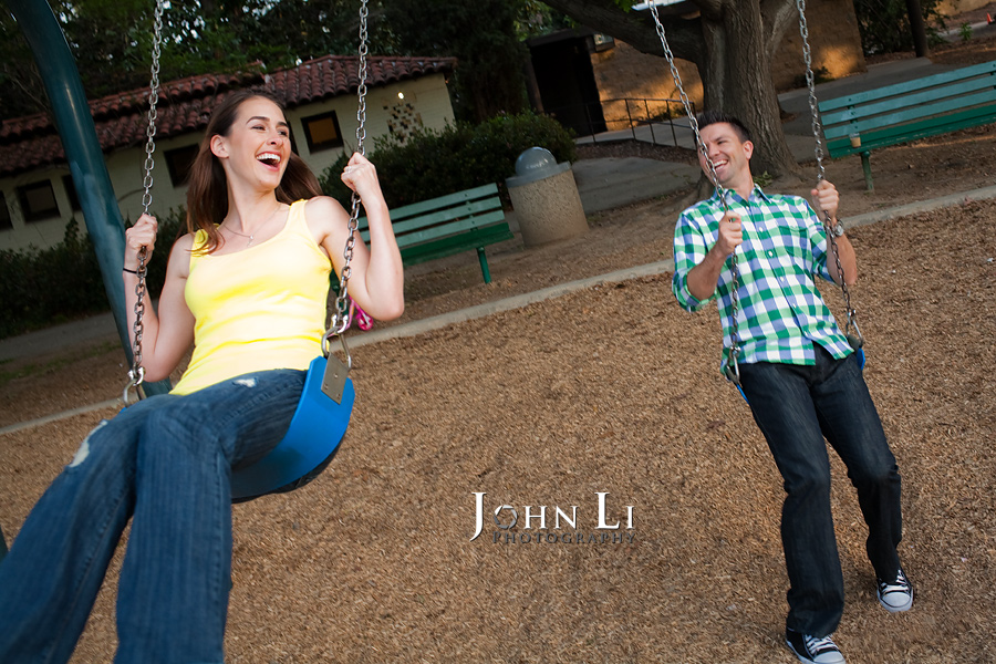 Swing engagement photos in Lacy park