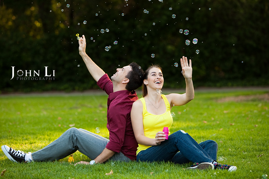 couple play Bubble lacy park engagement photography