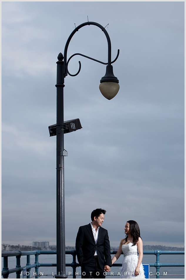 Engagement photographer on pier in Santa Monica