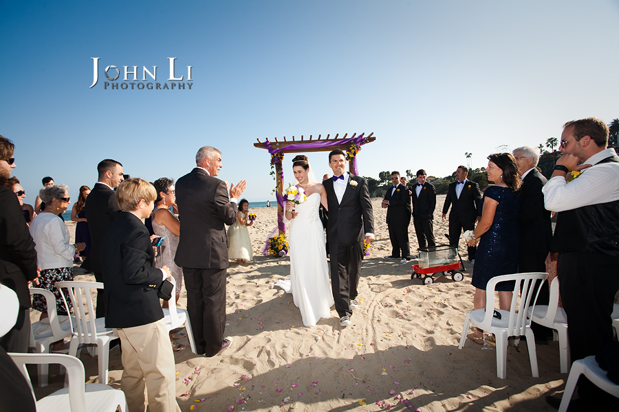 Leadbetter beach wedding bride and groom walk down the asiel