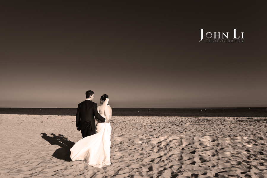 just married couple walk on the beach