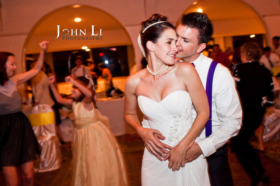 bride and groom dance in cabrillo pavilion arts center wedding reception