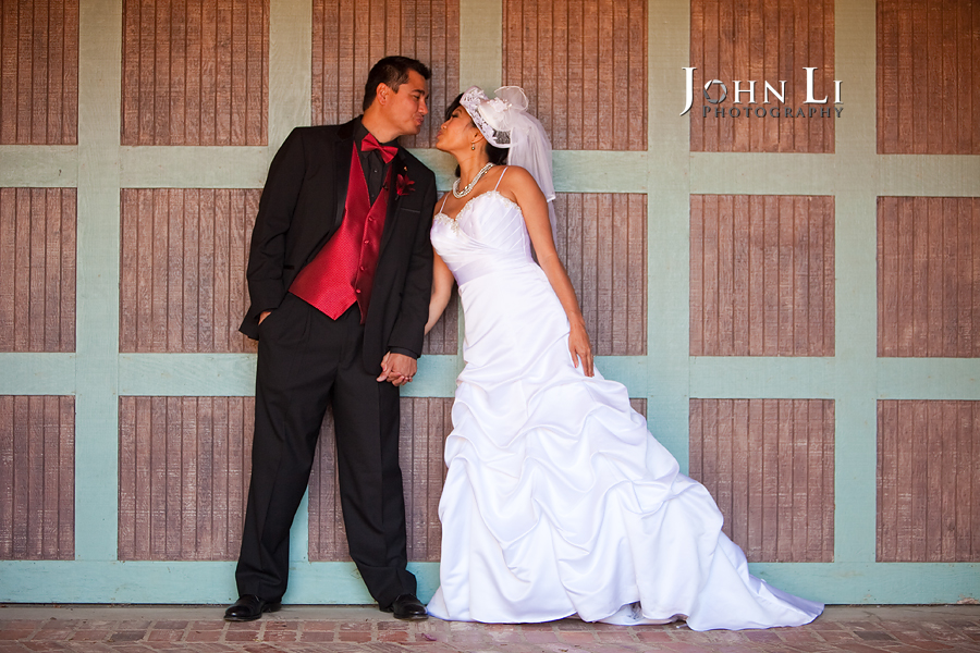 bride and groom kiss in vista de oro wedding