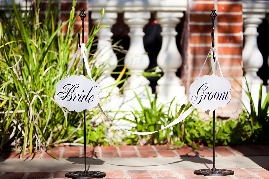 bride and groom signs in vista de oro wedding