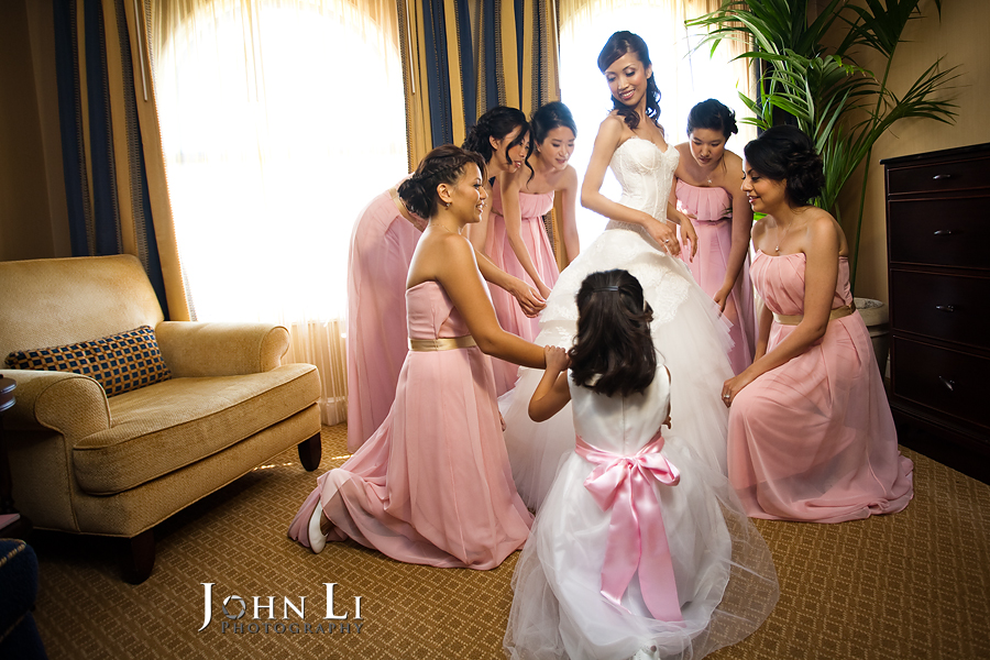 08 wedding party help bride with dress