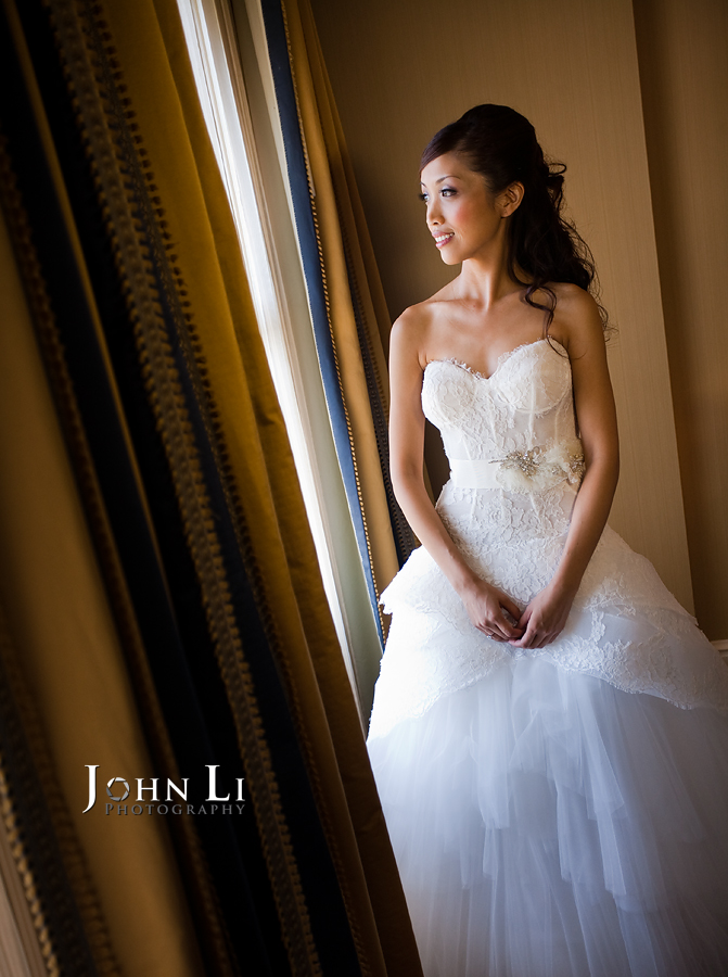 14 bride in front of window of langham hotel