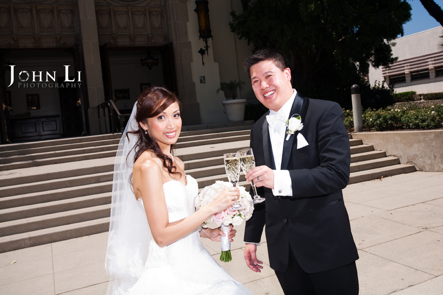 bride and groom drink champagene Holy Family Church South Pasadena