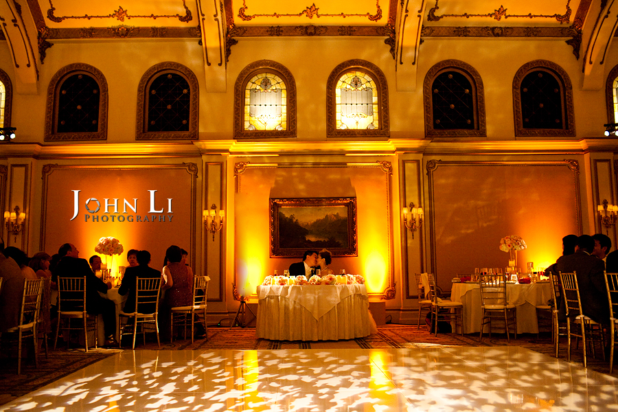 bride and groom kiss in a chinese wedding Langham Hotel