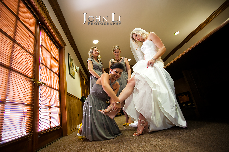 Limoneira Ranch Wedding photos girls help with wedding shoes