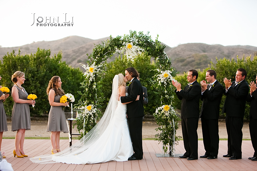 Limoneira Ranch Wedding ceremony kiss the bride