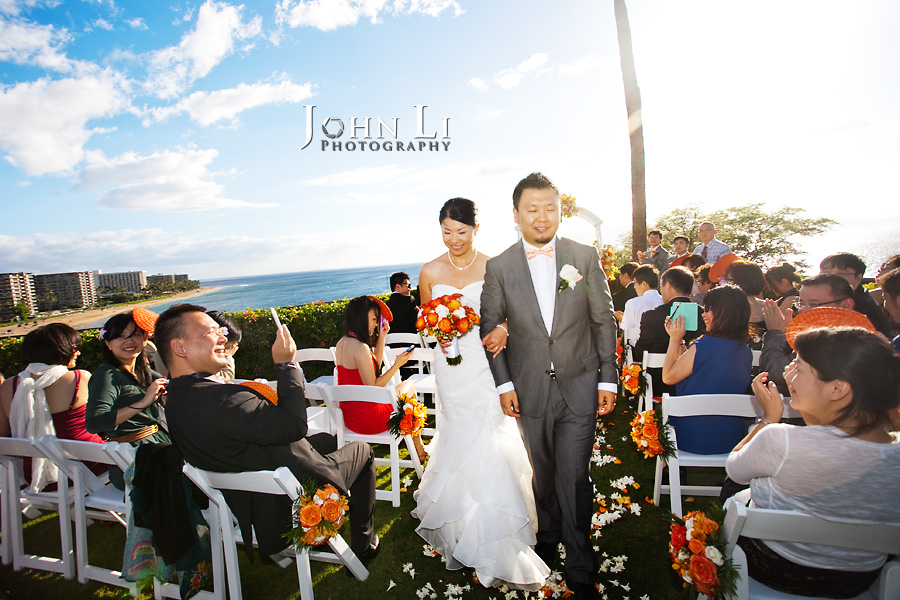 bride and groom walk down the aisel in Sheraton Maui wedding ceremony